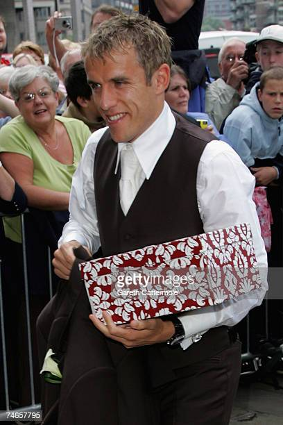 Phil Neville arrives at Manchester Cathedral for the wedding of footballer Gary Neville and Emma Hadfield on June 16 2007 in Manchester England