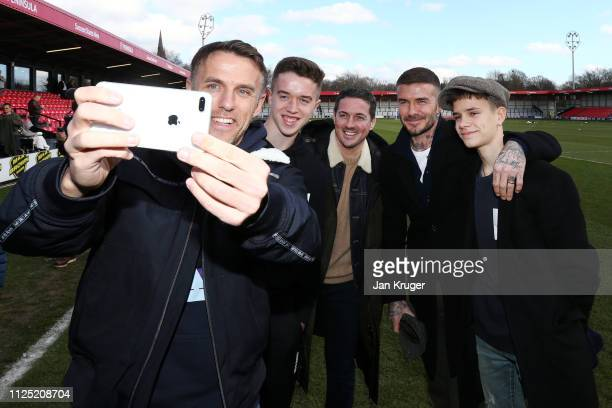 Phil Neville, England Women's manager and Salford City Co-Owner takes a selfie photograph with Salford City Co-Owner David Beckham, Romeo James...