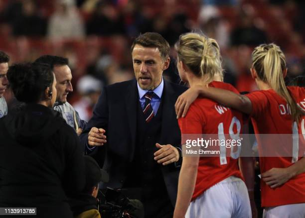 Phil Neville head coach of England talks to players after the 2019 SheBelieves Cup match between England and Japan at Raymond James Stadium on March...