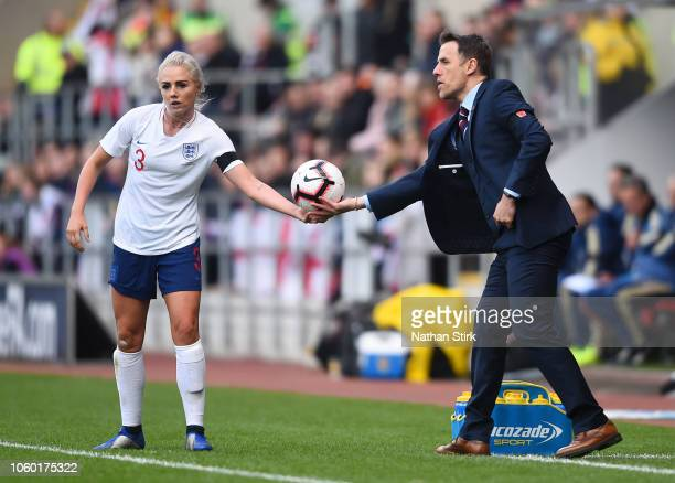 Phil Neville manager of England hands the ball to Alex Greenwood of England during the International Friendly match between England Women and Sweden...