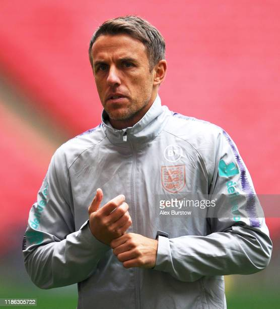 Phil Neville, Manager of England looks on during the England training session on the eve of the Women's International Friendly between England and...