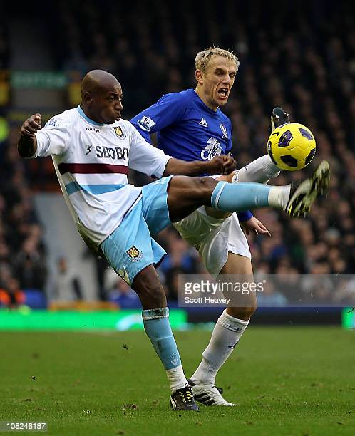 Phil Neville of Everton in action with Luis Boa Morte of West Ham during the Barclays Premier League match between Everton and West Ham United at...