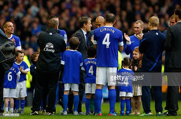 Phil Neville of Everton is clapped onto the pitch by team mates after the Barclays Premier League match between Everton and West Ham United at...