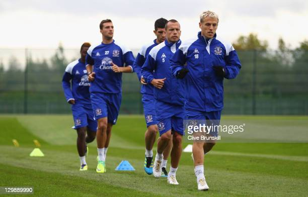 Phil Neville of Everton leads his team mates during an Everton training session at Finch Farm on October 21 2011 in Liverpool England