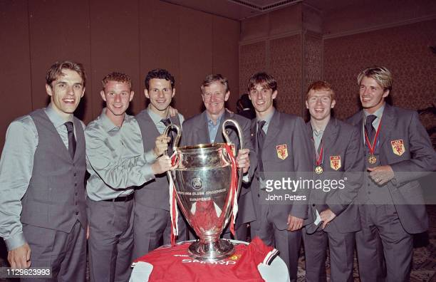 Phil NevilleNicky ButtRyan Giggs Eric HarrisonManchester United Youth Team CoachGary Neville Paul ScholesDavid Beckham pose with the Champions League...