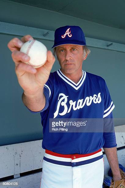 Phil Niekro of the Atlanta Braves poses for a portrait while displaying a knuckleball grip Niekro played for the Braves from 19661983 and in 1987