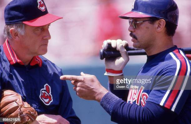 Phil Niekro of the Cleveland Indians talk to Reggie Jackson of the California Angels at the Big A circa 1986 in AnaheimCalifornia