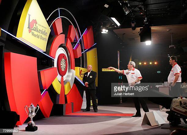 Phil Nixon of England in action against Martin Adams of England during the Final Of The BDO World Darts Championships at the Lakeside Country Club on...
