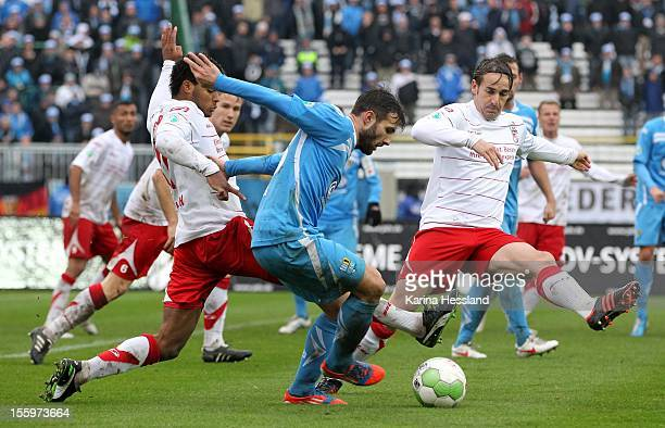 Phil OfosuAyeh and Bernd Rauw of Erfurt challenges Sascha Pfeffer of Chemnitz during the Third League match between RW Erfurt and Chemnitzer FC at...