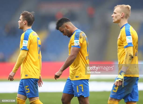 Phil OfosuAyeh Christoffer Nyman and Saulo Igor Decarli of Braunschweig look dejected after the Second Bundesliga match between Eintracht...