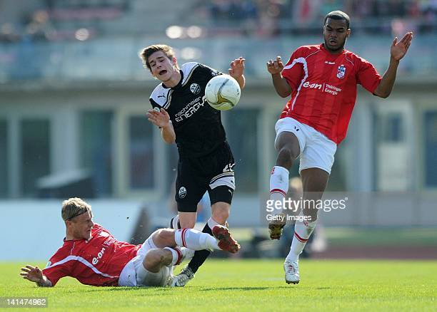 Phil OfosuAyeh Marco Engelhardt of Erfurt and Marcel Kandziora of Sandhausen battle for the ball during the Third League match between Rot Weiss...
