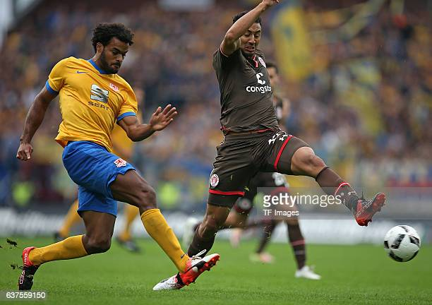 Phil OfosuAyeh of Braunschweig and Aziz Bouhaddouz of Pauli battle for the ball during the Second Bandesliga match between FC St Pauli and Eintracht...