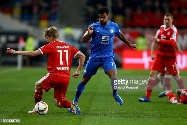 Phil OfosuAyeh of Braunschweig challenges Axel Bellinghausen of Duesseldorf during the Second Bundesliga match between Fortuna Duesseldorf and...