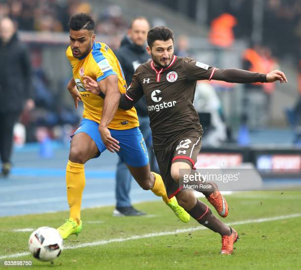 Phil OfosuAyeh of Braunschweig is challenged by Enver Cenk Sahin of St Pauli during the Second Bundesliga match between Eintracht Braunschweig and FC...