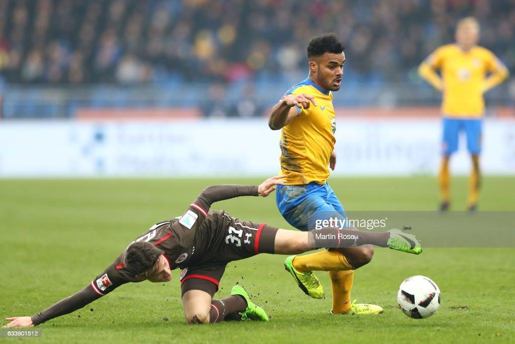 Phil Ofosu-Ayeh of Braunschweig is challenged by Maurice Jerome Litka of St. Pauli during the Second Bundesliga match between Eintracht Braunschweig and FC St. Pauli at Eintracht Stadion on February 5, 2017 in Braunschweig, Germany.