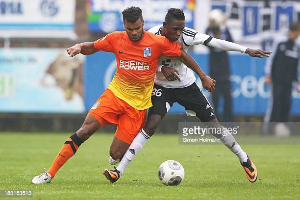 Phil OfosuAyeh of Duisburg is challenged by Frederick Kyereh of Elversberg during the Third Bundesliga match between SV 07 Elversberg and MSV...