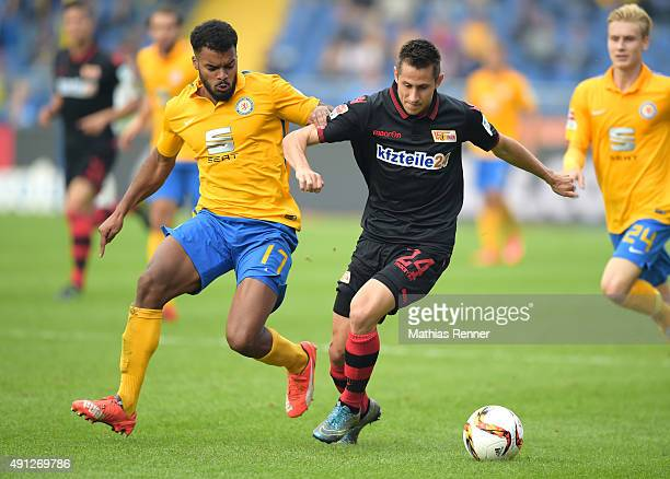 Phil OfosuAyeh of Eintracht Braunschweig and Steven Skrzybski of 1 FC Union Berlin during the Second Bundesliga match between Eintracht Braunschweig...