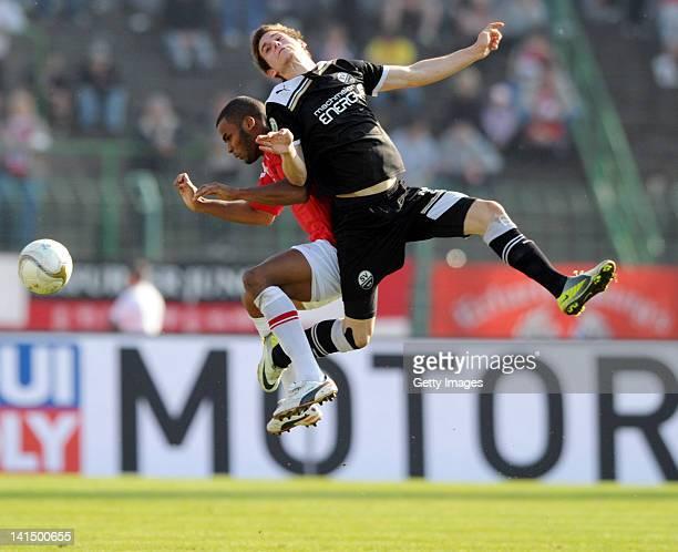 Phil OfosuAyeh of Erfurt and Marcel Kandziora of Sandhausen battle for the ball during the Third League match at Steigerwald Stadium on March 17 2012...