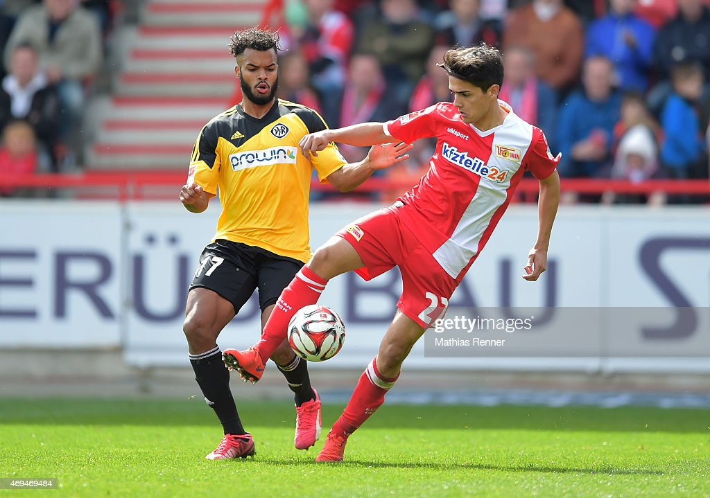 Phil Ofosu-Ayeh of VfR Aalen and Eroll Zejnullahu of 1 FC Union Berlin during the game between Union Berlin and VfR Aalen on april 12, 2015 in Berlin, Germany.