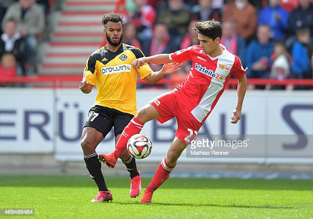 Phil OfosuAyeh of VfR Aalen and Eroll Zejnullahu of 1 FC Union Berlin during the game between Union Berlin and VfR Aalen on april 12 2015 in Berlin...