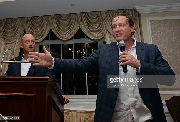 Phil Orlando and Jeremy Roenick attend Players Against Concussions at Pelham Country Club on October 6 2014 in Pelham Manor New York