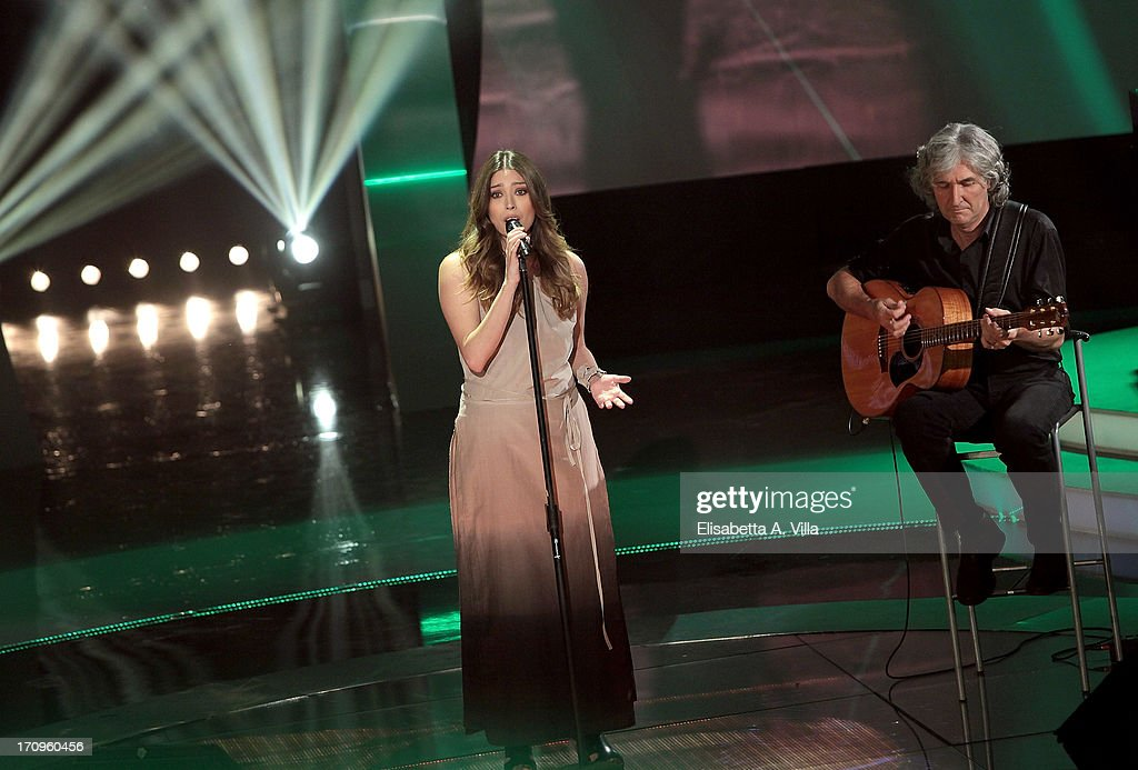Phil Palmer and singer Paris performe during the Premio Bellisario 2013 at Dear RAI studios on June 20, 2013 in Rome, Italy.
