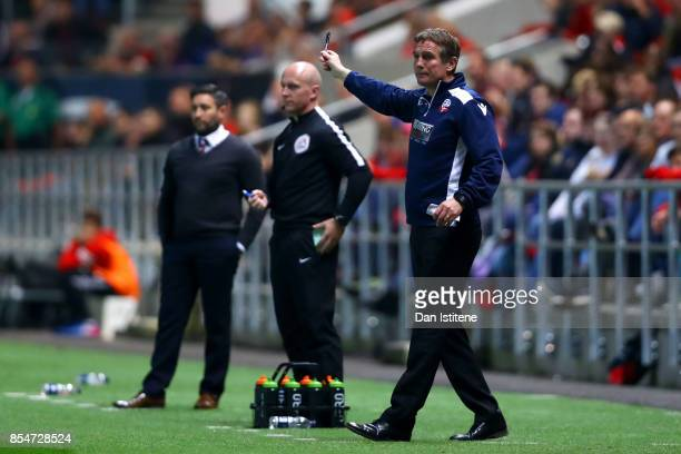 Phil Parkinson manager of Bolton Wanderers reacts on the touchline next to Lee Johnson manager of Bristol City during the Sky Bet Championship match...
