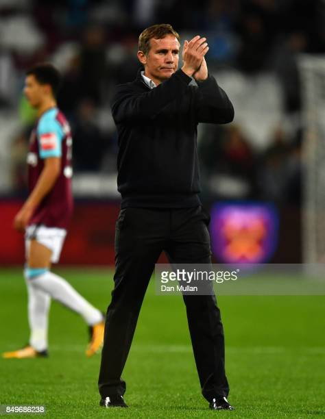 Phil Parkinson manager of Bolton Wanderers shows appreciation to the fans after the Carabao Cup Third Round match between West Ham United and Bolton...