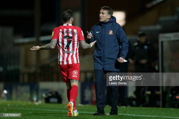 Phil Parkinson, manager of Sunderland speaks to Chris Maguire of Sunderland during the Sky Bet League One match between Rochdale and Sunderland at...