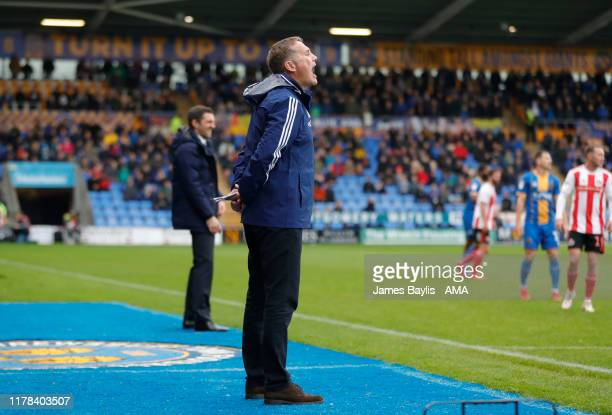 Phil Parkinson the head coach / manager of Sunderland during the Sky Bet League One match between Shrewsbury Town and Sunderland at Montgomery Waters...