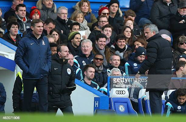 Phil Parkinson the manager of Bradford City and Jose Mourinho manager of Chelsea exchange words during the FA Cup Fourth Round match between Chelsea...