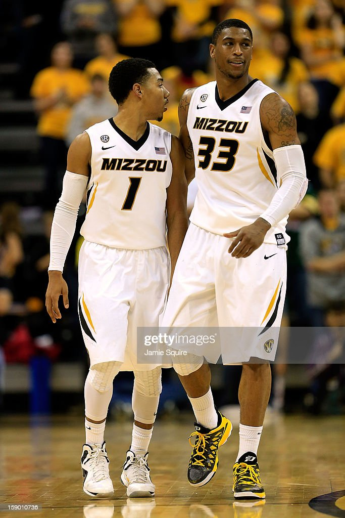 Phil Pressey #1 and Earnest Ross #33 of the Missouri Tigers react during the game against the Bucknell Bison at Mizzou Arena on January 5, 2013 in Columbia, Missouri.