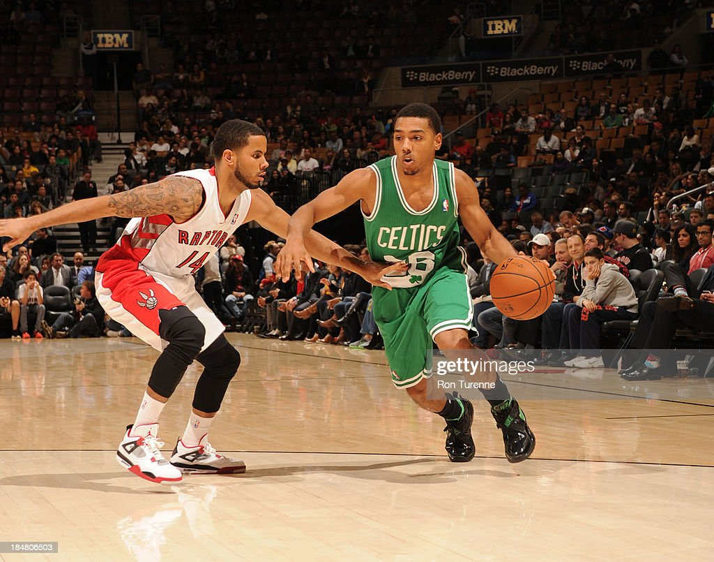 Phil Pressey #26 of the Boston Celtics drives to the basket against D.J. Augustin #14 of the Toronto Raptors during the game on October 16, 2013 at the Air Canada Centre in Toronto, Ontario, Canada.