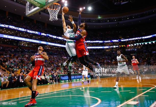 Phil Pressey of the Boston Celtics goes up for a layup in front of John Wall of the Washington Wizards in the first quarter during the game at TD...