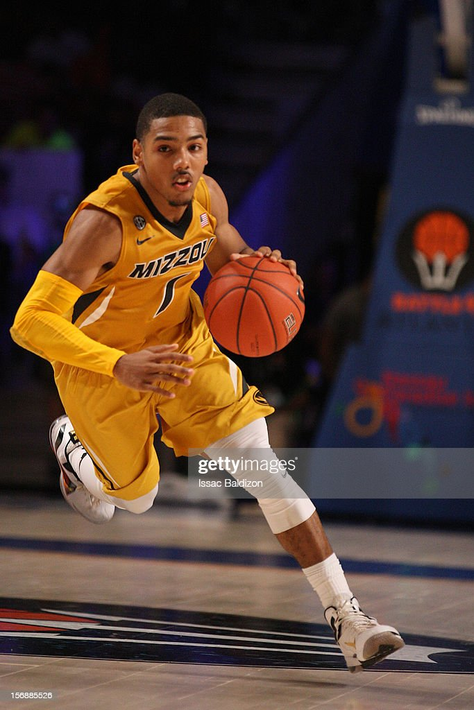 Phil Pressey #1 of the Missouri Tigers dribbles against the Louisville Cardinals during the Battle 4 Atlantis tournament at Atlantis Resort November 23, 2012 in Nassau, Paradise Island, Bahamas.