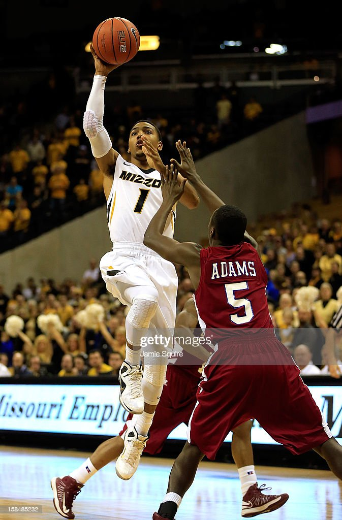 Phil Pressey #1 of the Missouri Tigers shoots over Louis Adams #5 of the South Carolina State Bulldogs during the game at Mizzou Arena on December 17, 2012 in Columbia, Missouri.