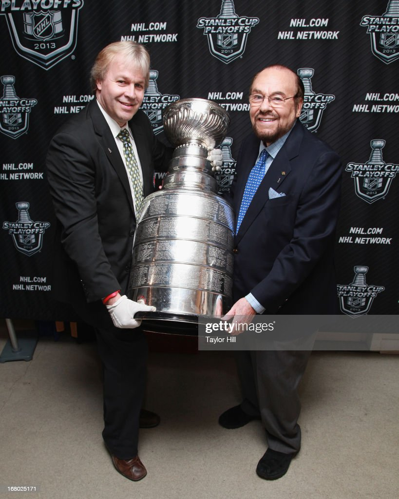 Phil Pritchard and James Lipton attend the James Lipton and Stanley Cup in store event at NHL powered by Reebok Store on May 3, 2013 in New York City.