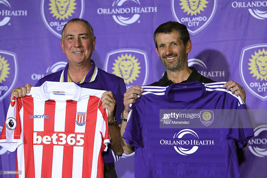 Phil Rawlins, Orlando City President, (L) and Tony Scholes, Stoke City President announce a formal partnership between the two clubs prior to a MLS soccer match between the New York Red Bulls and the Orlando City SC at Camping World Stadium on May 6, 2016 in Orlando, Florida.
