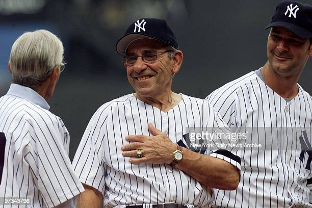 Phil Rizzutto Yogi Berra and Don Mattingly during introductions for the annual OldTimers' Day festivities at Yankee Stadium