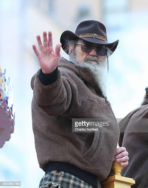 Phil Robertson of AE television's Duck Dynasty waves to the crowd during the 87th Annual Macy's Thanksgiving Day Parade on November 28 2013 in New...