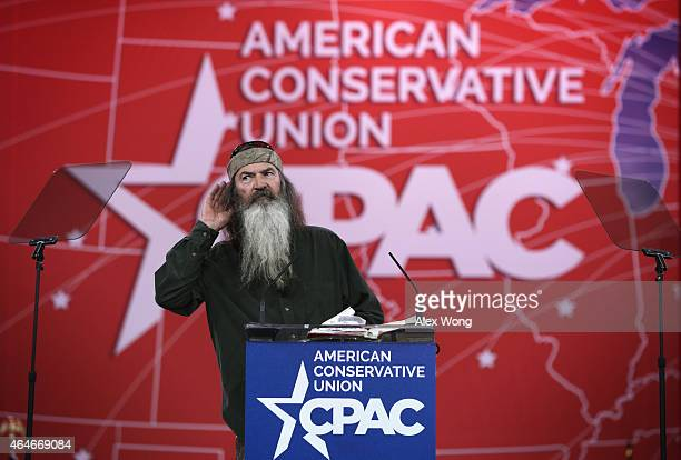 Phil Robertson of TV show Duck Dynasty gestures as he speaks at the 42nd annual Conservative Political Action Conference February 27 2015 in National...