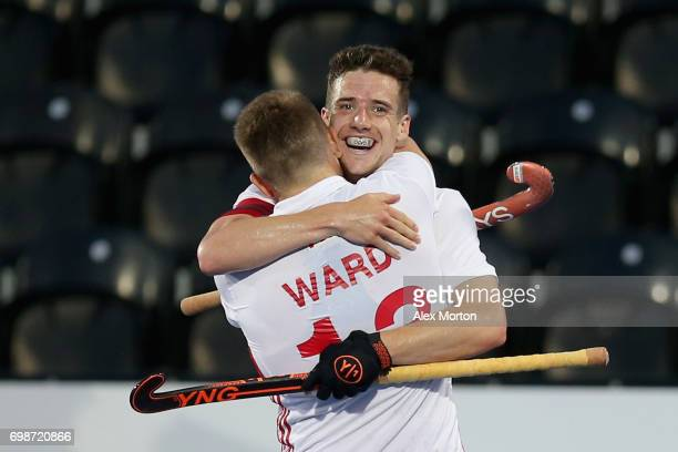 Phil Roper of England celebrates scoring his sides fifth goal with Sam Ward of England during the Pool A match between England and South Korea on day...