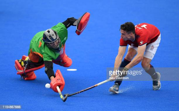 Phil Roper of Great Britain attempts to get past Tyler Lovell of Australia during penalty flicks during the Men's FIH Field Hockey Pro League match...