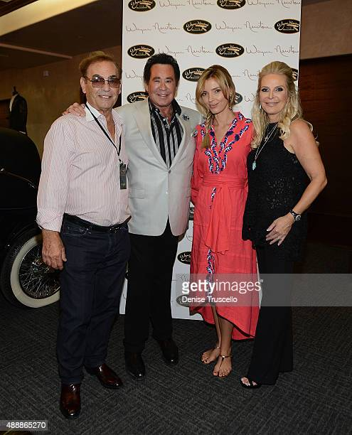 Phil Ruffin Wayne Newton Oleksandra NikolayenkoRuffin and Kathleen McCrone Newton attend the VIP opening of Casa De Shenandoah on September 17 2015...