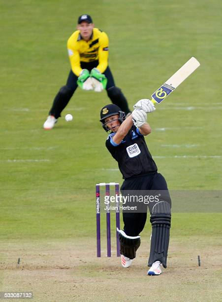 Phil Salt of Sussex Sharks scores runs as wicket keeper Craig Cachopa of Gloustershire looks on during the NatWest T20 Blast match between...