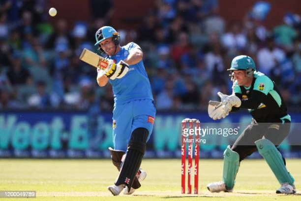 Phil Salt of the Strikers hits a six during the Big Bash League match between the Adelaide Strikers and the Brisbane Heat at the Adelaide Oval on...
