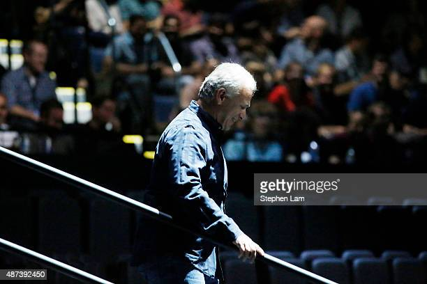 Phil Schiller Apple Senior Vice President of Worldwide Marketing walks down a flight of stairs before an Apple Special Event at Bill Graham Civic...