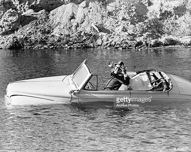 Phil Silvers in car sinking in lake in a scene from the film 'It's A Mad Mad Mad Mad World' 1963