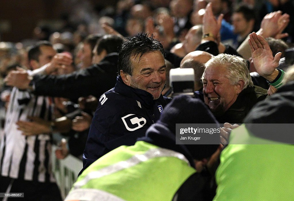Phil Simkin, Manager of Dorchester Town celebrates the win with fans during the FA Cup with Budweiser 1st Round match between Dorchester Town and Plymouth Argyle at The Avenue Stadium on November 4, 2012 in Dorchester, England.