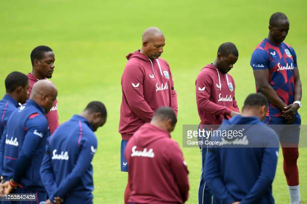 Phil Simmons Head Coach of the West Indies observes a minutes silence alongside his team in memory of former West Indies batsman Sir Everton Weekes...